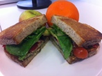 Tuna, Pesto & Spinach Salad Sandwich -Finished Product & served with a Fuji Apple & Mandarin