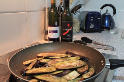 Eggplant with olive oil in a pan dusted with rosemary