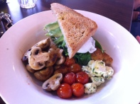 Fez Poached Eggs with grilled cherry tomatoes, avocado, spinach & herb fetta add Mushrooms
