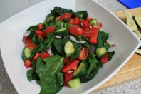 Toss the tomatoes, red onion & cucumber with English Spinach