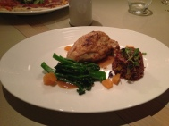 Chicken Breast with red rice & capsicum flan, sauteed broccolini & citrus jelly