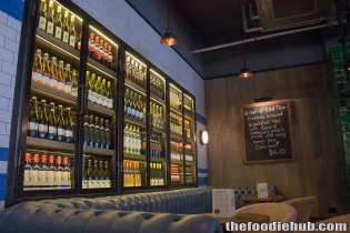 The Main Wine Fridge and Bar Seating Area