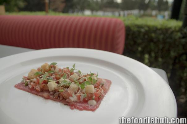 Beef carpaccio, tuna mayonnaise, tomato gremolata & brioche