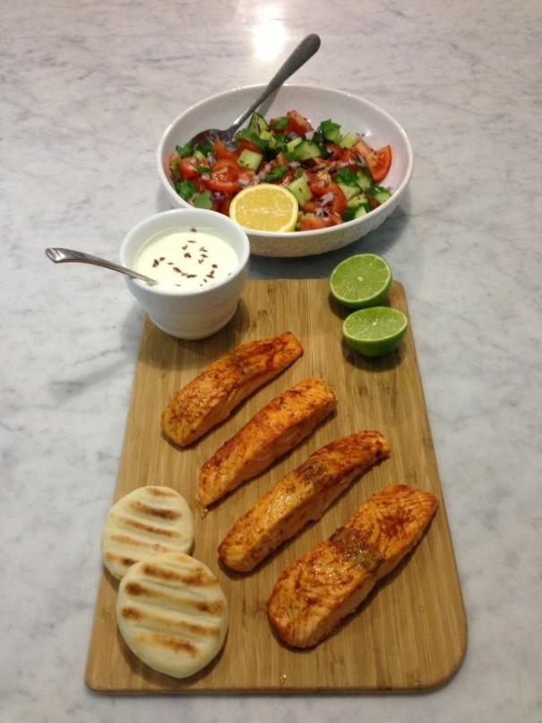 Tandoori Salmon with Tomato, Coriander & Cucumber Salad & Cumin Seeds served with Natural yoghurt Raita, lime and lemon3