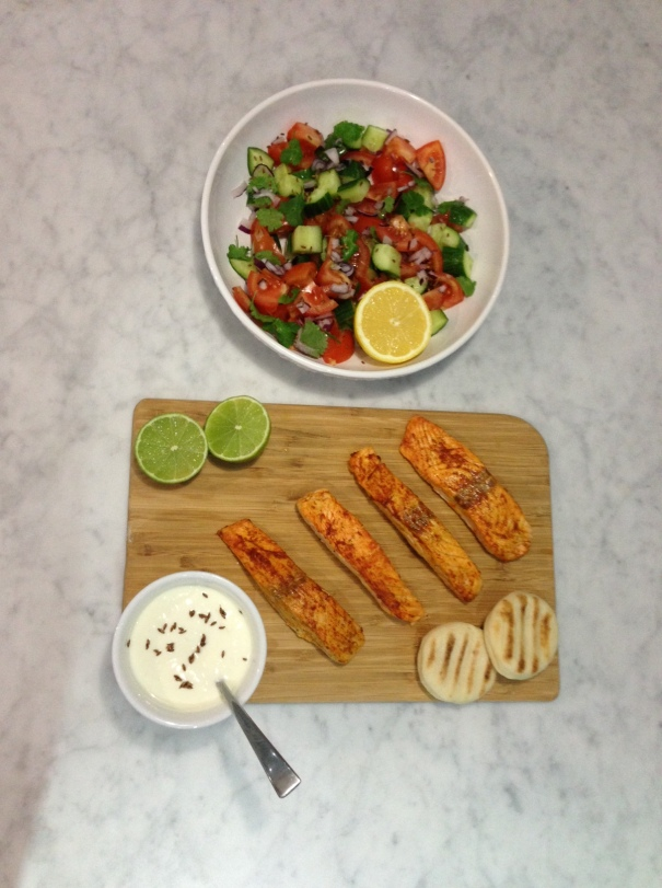 Tandoori Salmon with Tomato, Coriander & Cucumber Salad & Cumin Seeds served with Natural yoghurt Raita, lime and lemon 2
