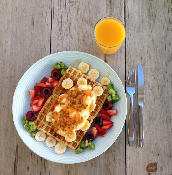 Waffles with natural yoghurt and passionfruit, cherries, kiwi fruit, strawberry & banana plus honey