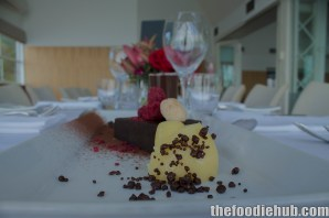 Chocolate pudding, chocolate sauce, popping chocolate, dried berries